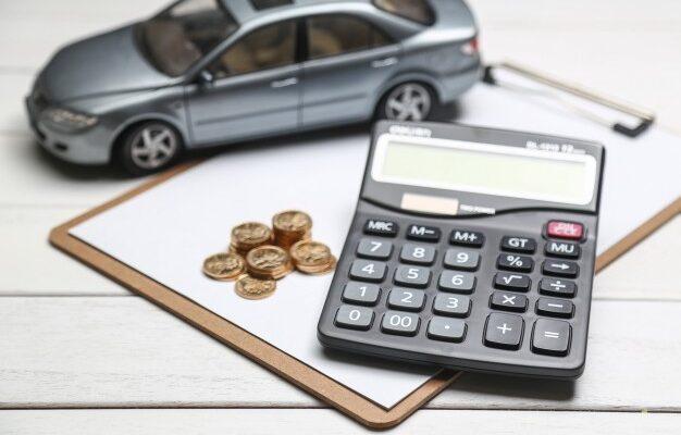 car-model-calculator-coins-white-table_1387-493